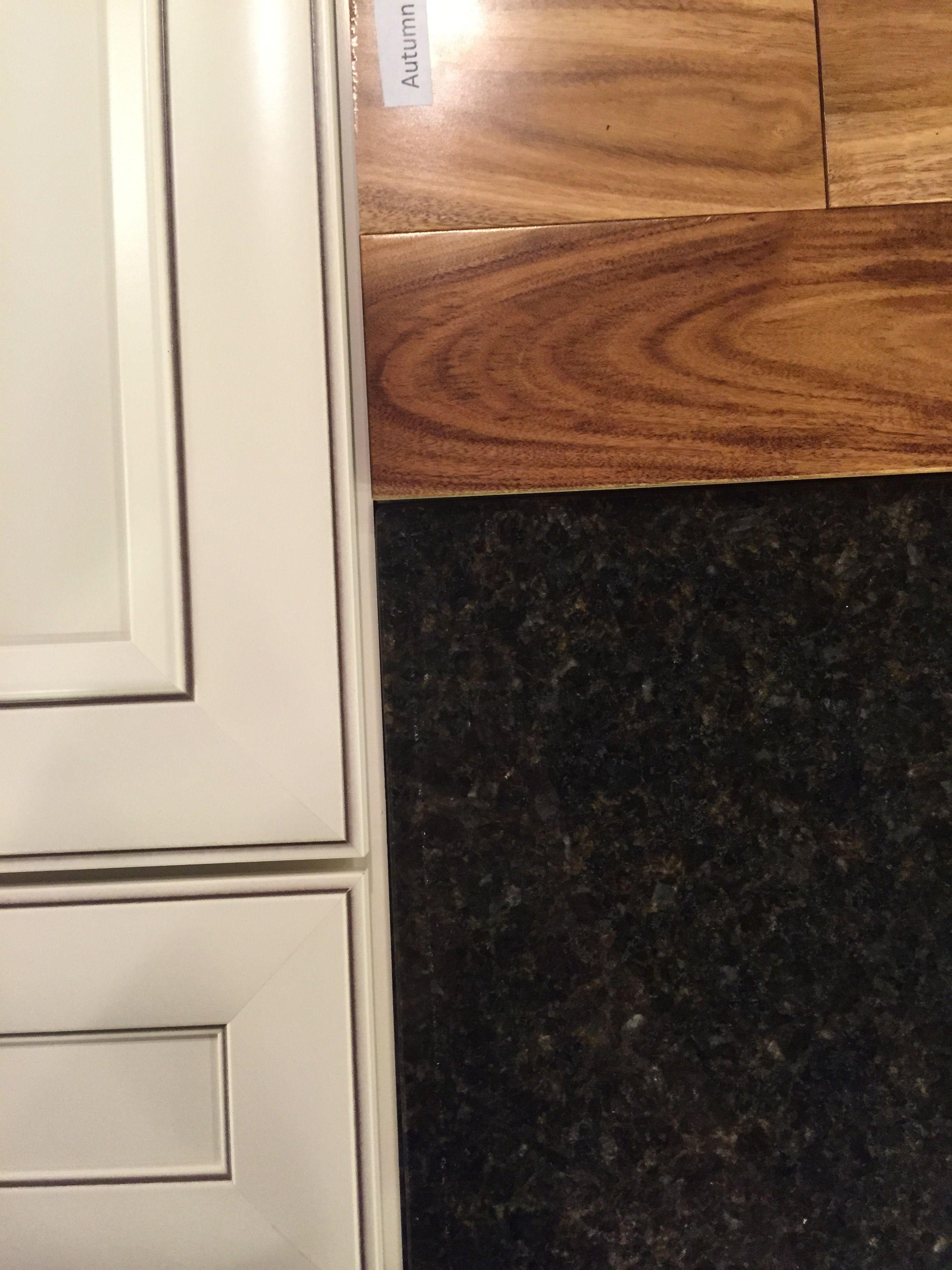 Dark uber tuber granite shown with white cabinets and manchester dark uber tuber granite shown with white cabinets and manchester wood floors in natural dailygadgetfo Images