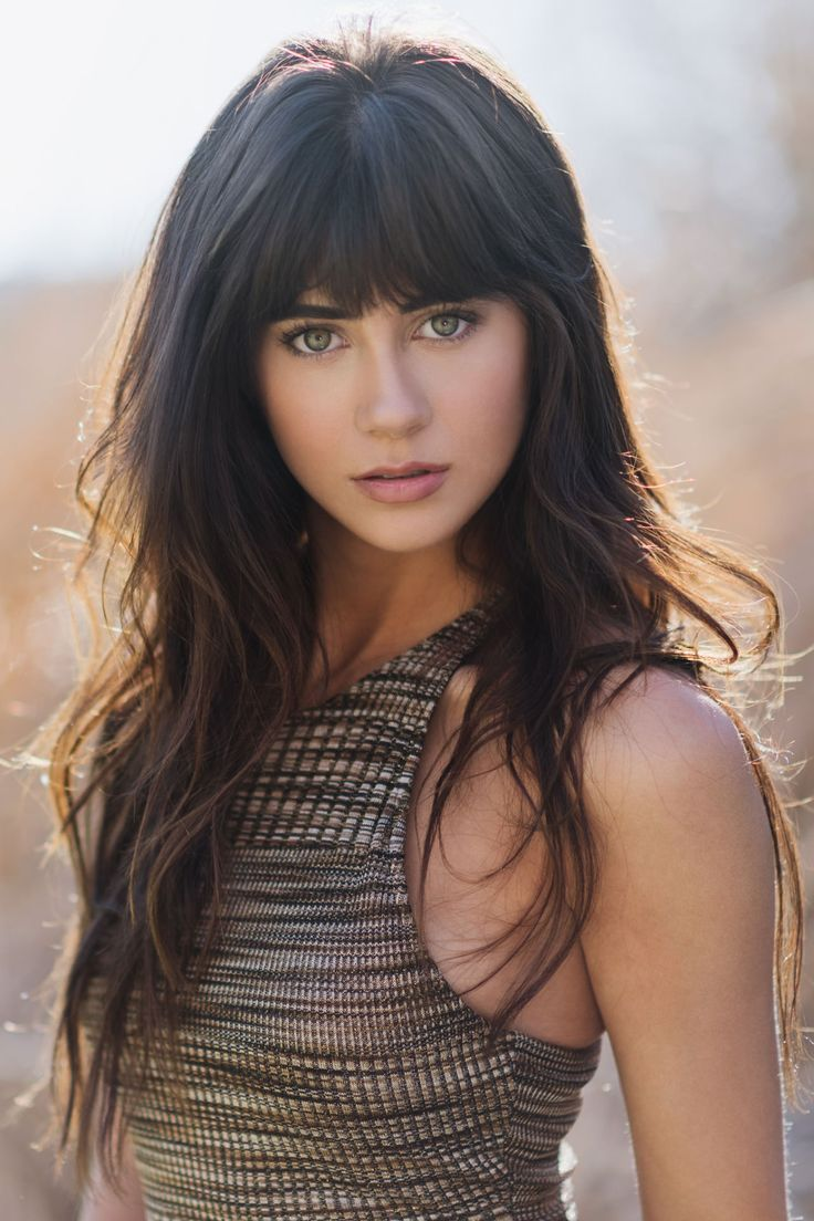Long Brunette Hairstyle With Bangs