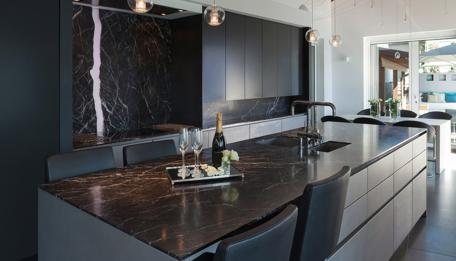 Marble countertop/backsplash with a totally flat glass