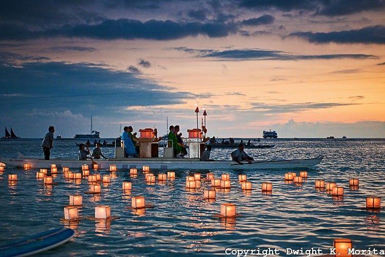 Monks shepherd floating lanterns launched at sunset