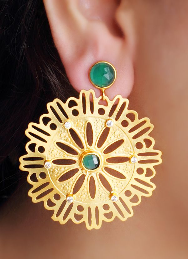 This striking pair of earrings by Urban Dhani features green onyx stones. Smooth green onyx stones adorn the top while the filigree work drop has a smaller green onyx stone at the centre. The delicate circular drops with their contemporary design make the earrings perfect to be teamed with both traditional and modern outfits.