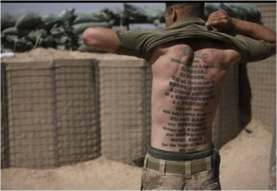 "A Marines tattoo on his back reads: ""USMC, trained, pushed & tested..., In SWEAT..., In BLOOD..., 'Till all that is left is, HONOR, COURAGE, & COMMITMENT, to a BROTHERHOOD, & a FREEDOM, that no man, can take away from us. Through PAIN, our STRENGTH, grows and BATTLE, our GLORY"