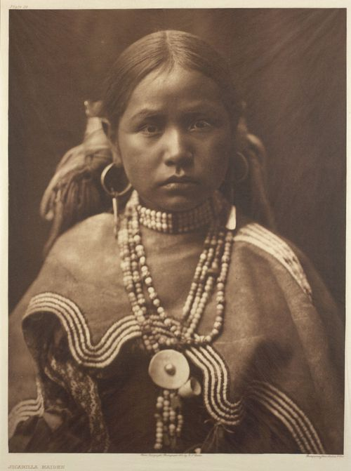 Jicarilla maiden.  Photograph by Edward S. Curtis, taken c. 1907-1930.