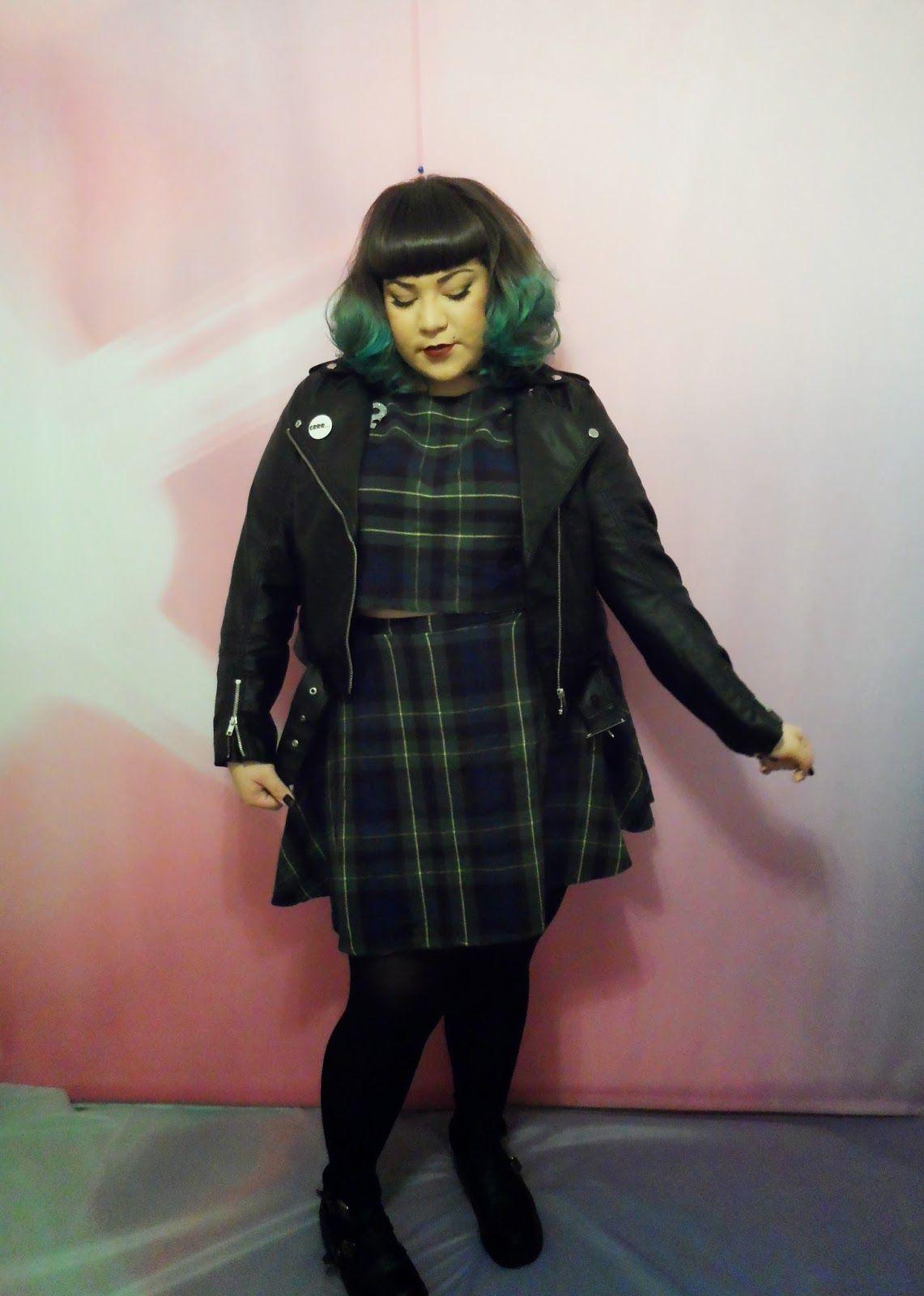 leather jacket +dress + brooch