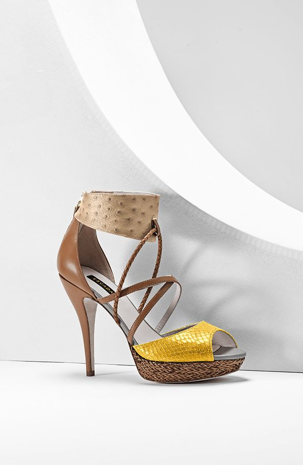 Sensational patchwork stilettos featuring a stunning mix of textures and styling: the ankle is braceleted by ostrich-embossed calfskin and the toes are banded in a contrast python look. A basket-weave texture sets off the one-inch plateau. 4-1/2 heels