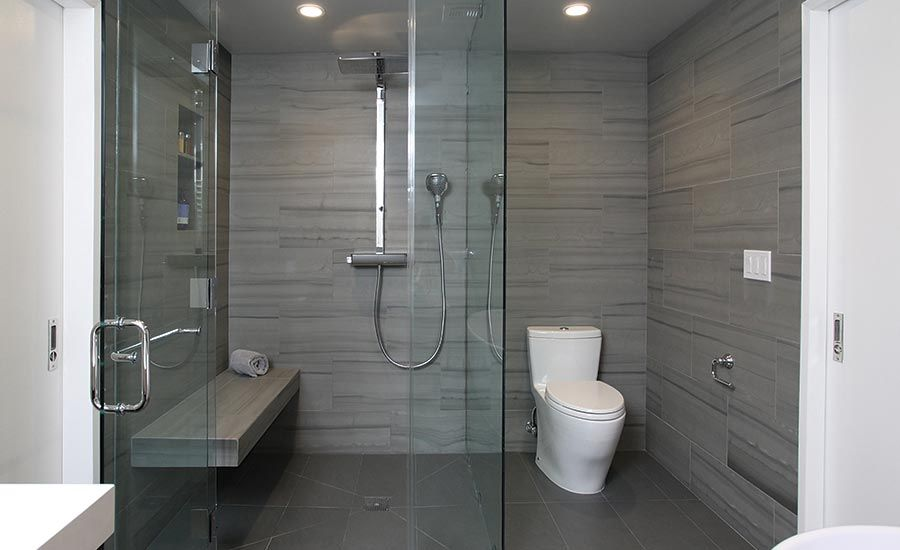 zero entry shower and floating bench to make room seem largers ...