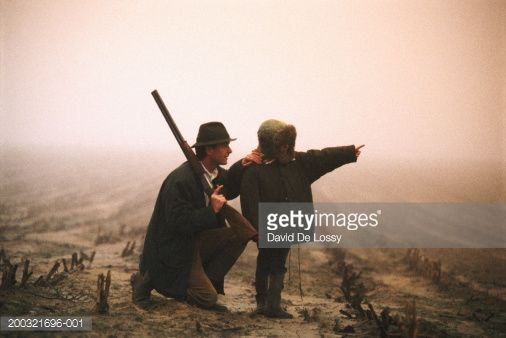 Stock Photo : Father with son (4-5) standing outdoors, boy pointing