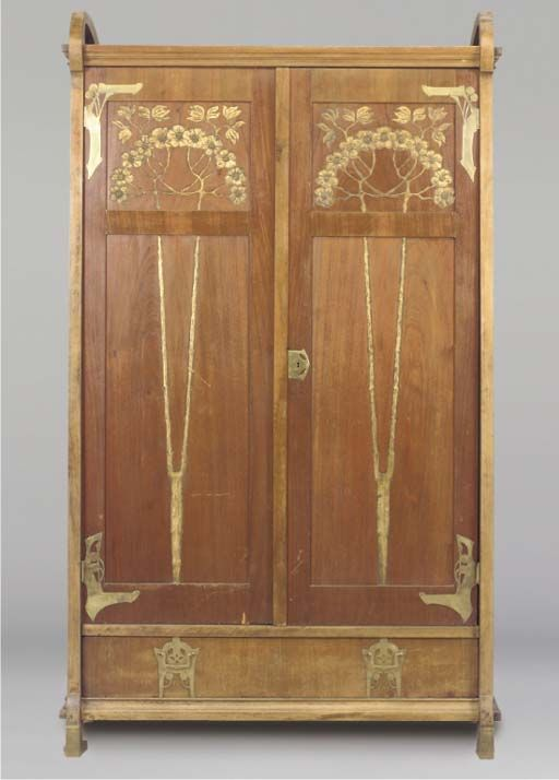 A BRASS-MOUNTED MAHOGANY WARDROBE -  ATTRIBUTED TO GUSTAVE SERRURIER-BOVY
