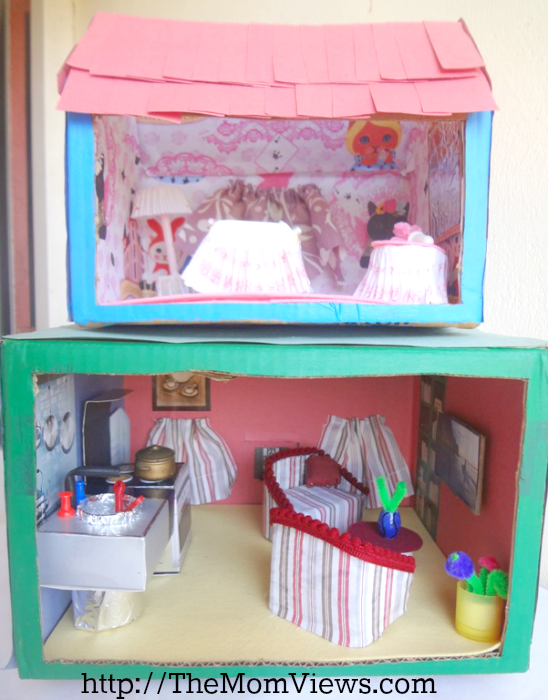A diy cardboard doll house made using recycled materials for Diy crafts using recycled materials