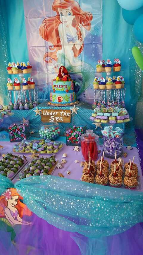 Little Mermaid Party Under The Sea Candy Table Caramel Apples Rolo Kisses Rice Krispy Cho Ariel Birthday Party Mermaid Theme Party Mermaid Birthday Party