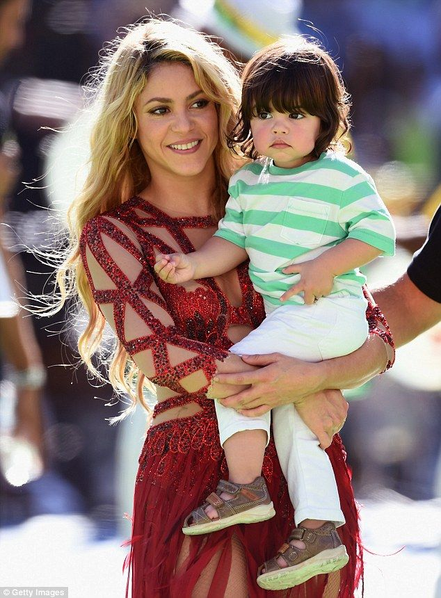 Shakira carries her son Milan after performing at the World Cup Final