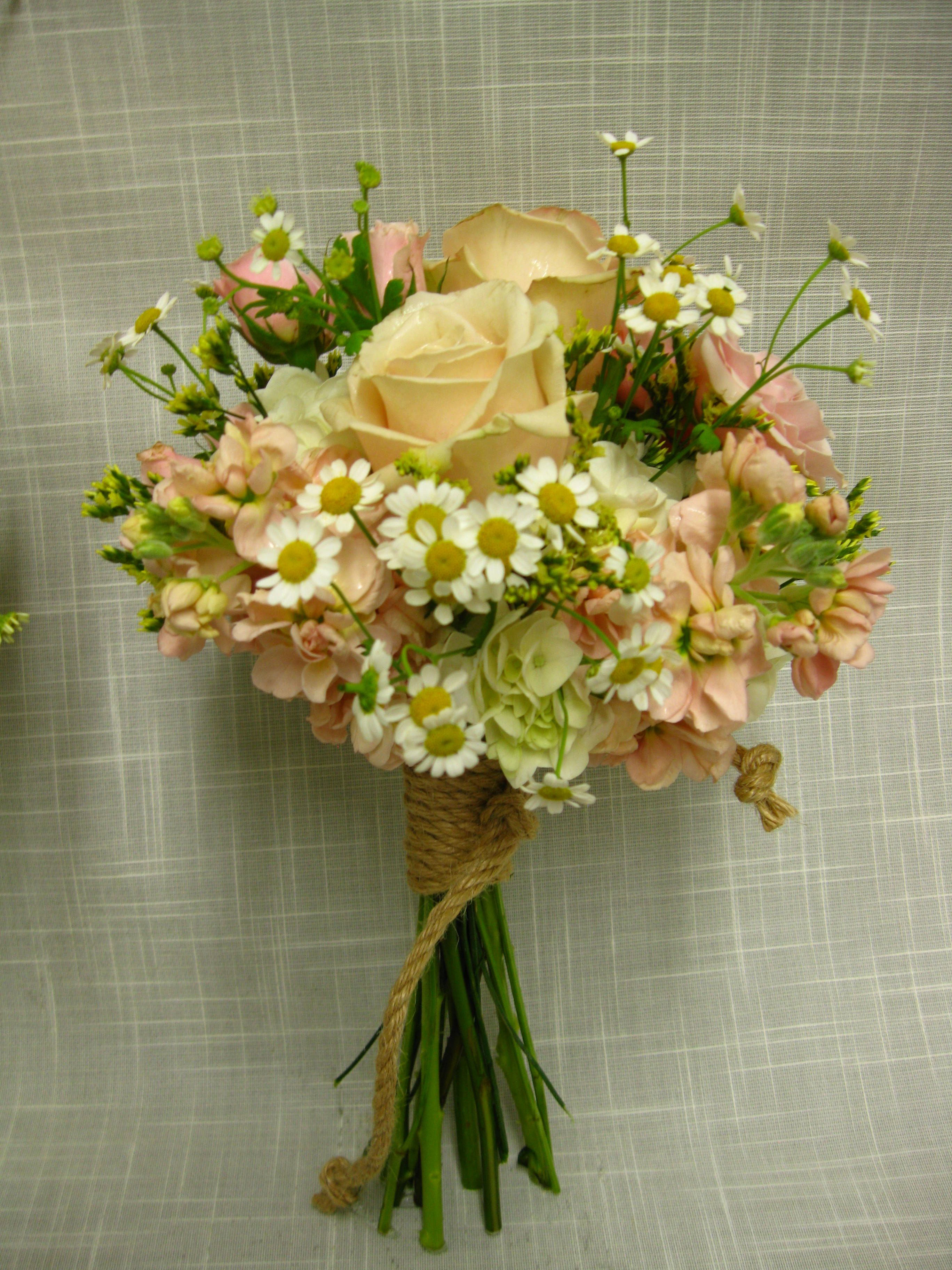 Simple elegant casual and slightly rustic handtied for Flower sprays for weddings