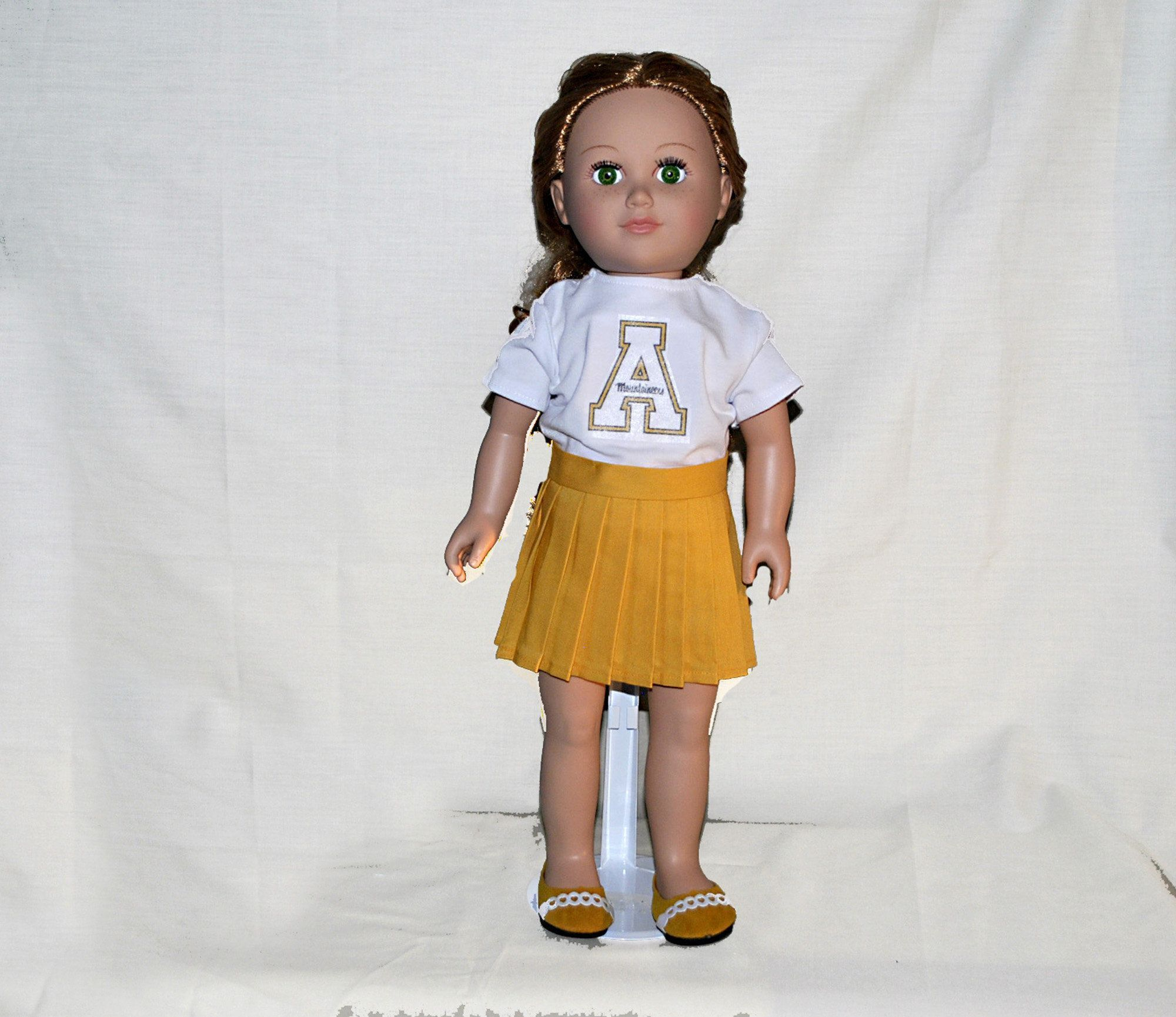 Sports Team Outfit Appalachian Cheerleader Yellow Skirt White T-shirt like American Girl #18inchcheerleaderclothes Appalachian Cheerleader sports team outfit costume for 18 inch American Made Girl Doll, Yellow Skirt, White T-shirt, Sneakers, Journey Girl, My Life, Our Generation Yellow Pleated skirt White T-shirt shoes Panties -The item in the picture will be the item you receive. -Doll clothes were sewn in a pet and a smoke free environment. -The doll and hair accessories (unless listed) is not #18inchcheerleaderclothes