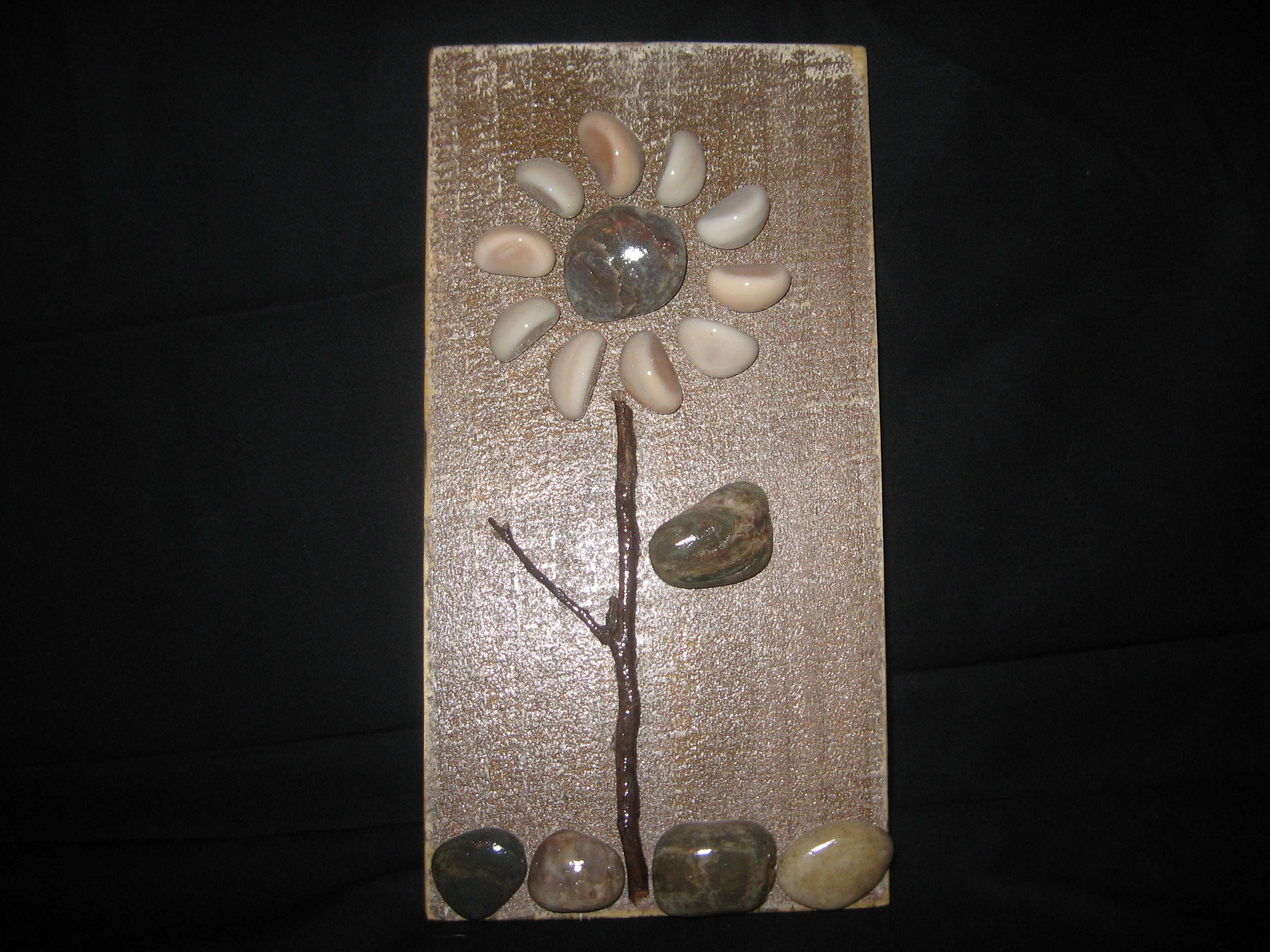 Flower wall art created with stones and wood mosaic style