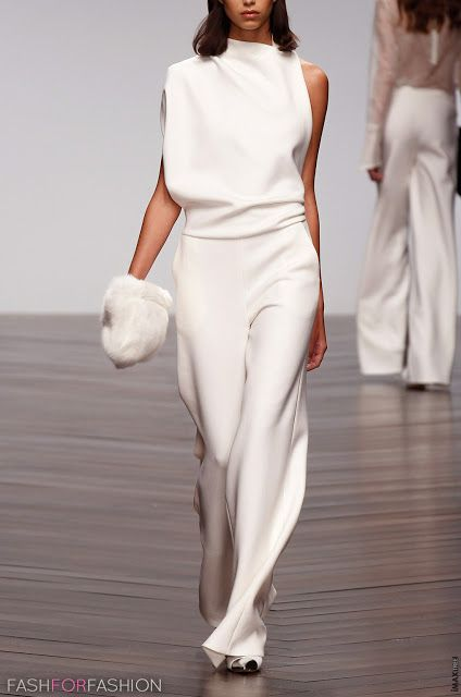 Elegant flowing white jumpsuit with matching white fur bag by Osman.