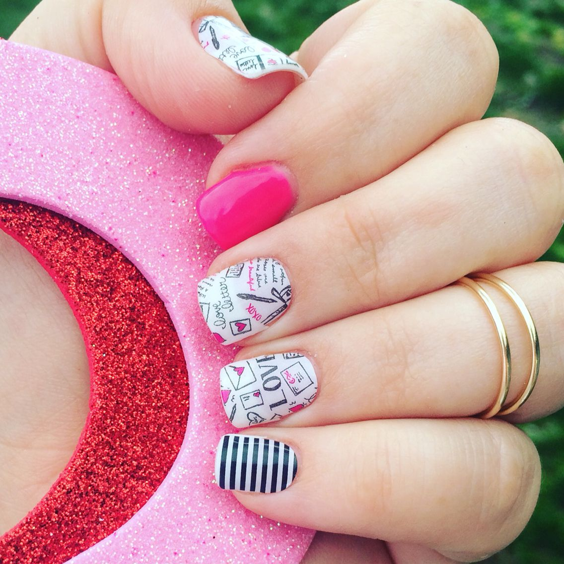 You can apply Jamberry wraps over clean, dry nails OR painted nails. I  usually