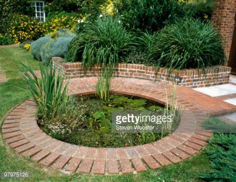 Brick used as edging for circular pond in garden pond for Garden pond edging