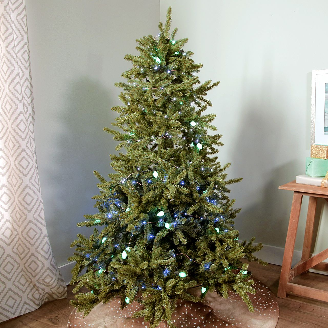 The Top Christmas Tree Decorating Trends According To Our Editors Christmas Tree Lighting Hanging Christmas Tree Hanging Christmas Lights