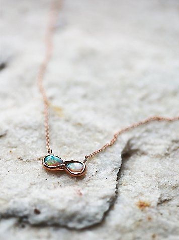 Infinite Possibility Opal Necklace | Delicate 14k rose gold necklace featuring an infinity shaped Australian opal pendant. Spring ring closure. American made.