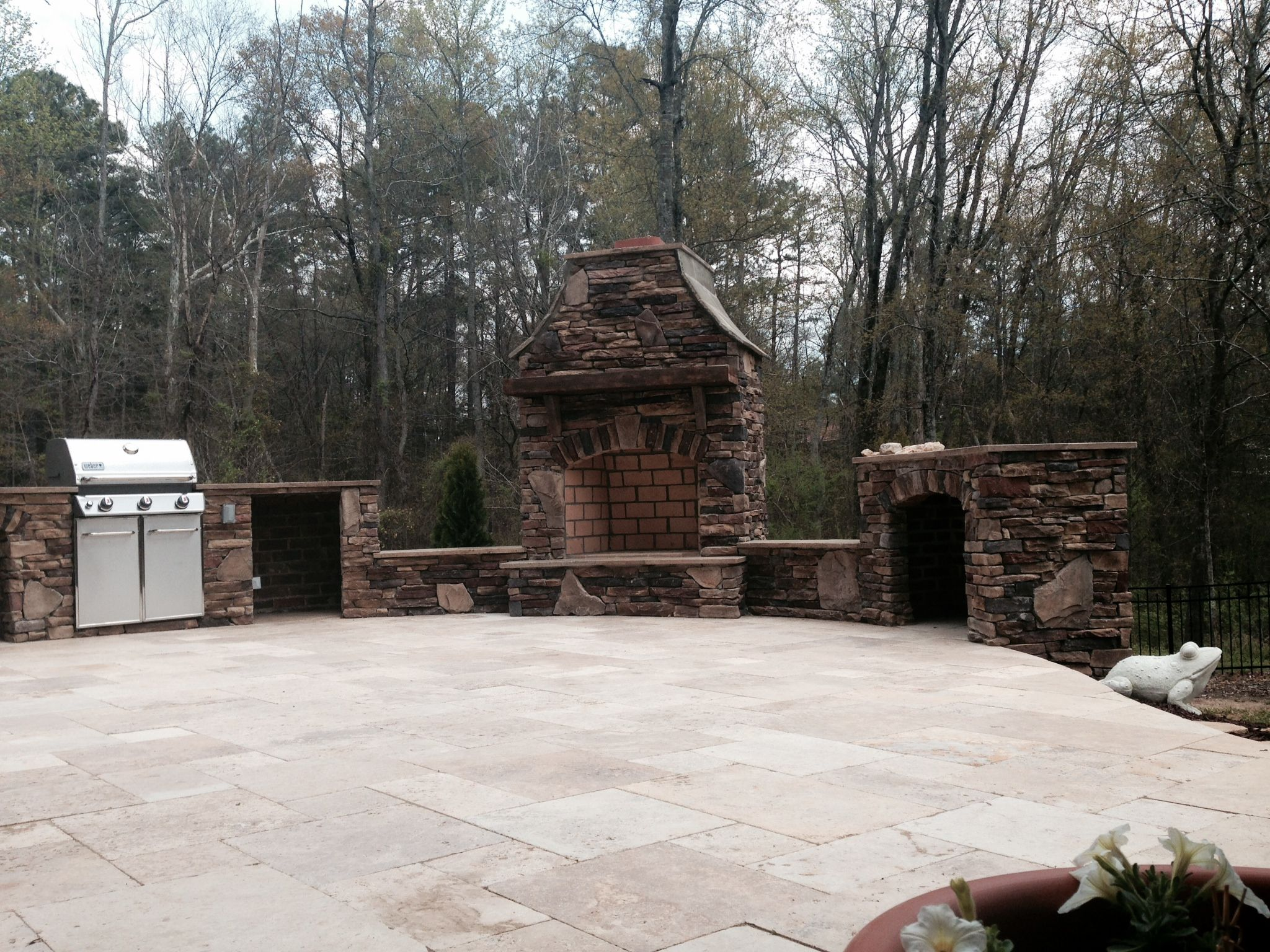 a french pattern travertine stone patio with a ledge stone outdoor