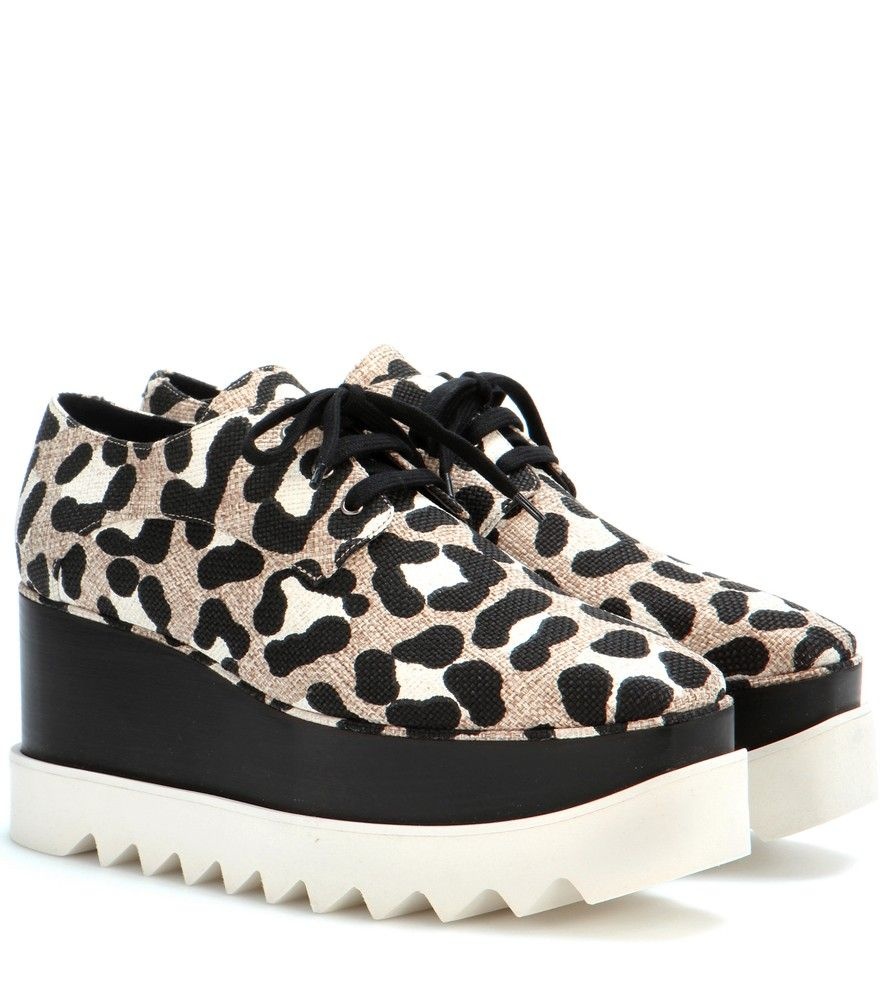 Stella McCartney - Elyse printed platform derby shoes - Stella McCartney's covetable Elyse design has been given a re-work for the new season, and we're loving the results. The wooden platform has been painted black, while the canvas upper is coated with an eye-catching leopard print. The style's distinctive sawtooth sole finishes this on a tough-luxe note. Wear yours as the finishing touch to distressed black denim looks. seen @ www.mytheresa.com