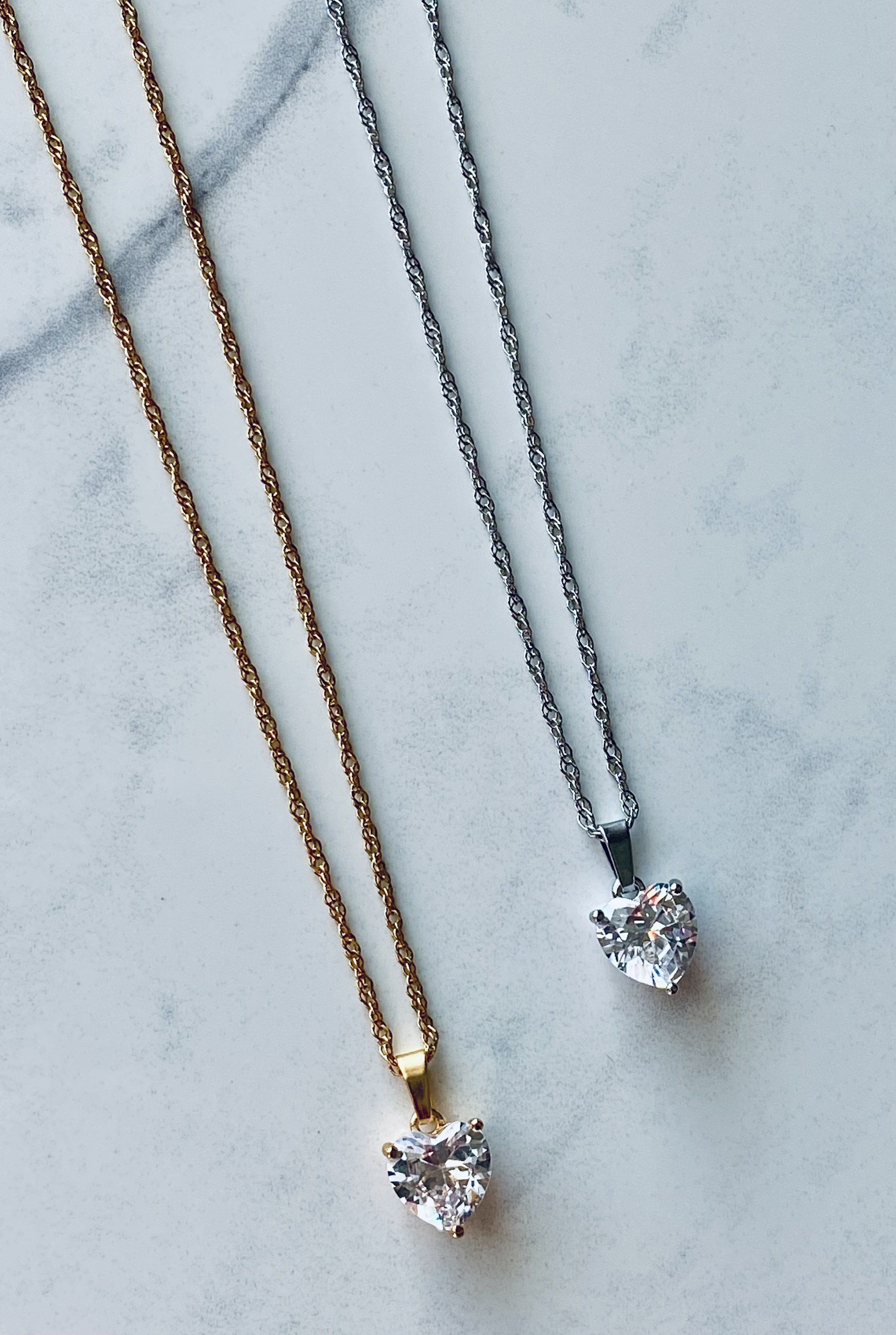 You're going to Love our Amor Pendant Chain! Zircon heart pendant on a stainless steel singapore twist chain. Available in gold or silver. 15 inches with 3 inch extender.