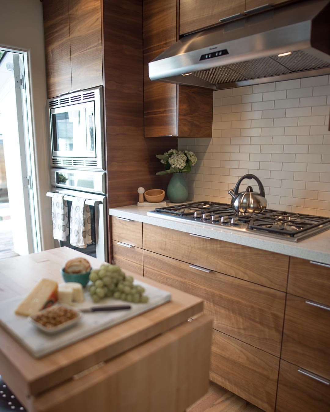 Love This Kitchen The Horizontal Grain Walnut Cabinets Pair So Beautifully With The Cream Heath Tile Ba Walnut Kitchen Cabinets Walnut Cabinets Walnut Kitchen