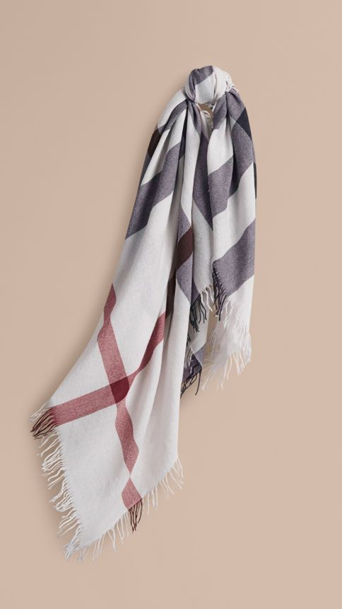 A check square Burberry scarf in extra fine Merino wool, made in a 200-year-old mill in Scotland.