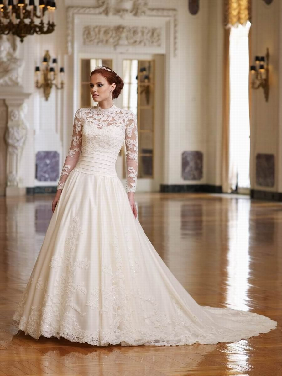 A traditional A-Line long-sleeved satin and lace gown. Gorgeous ...