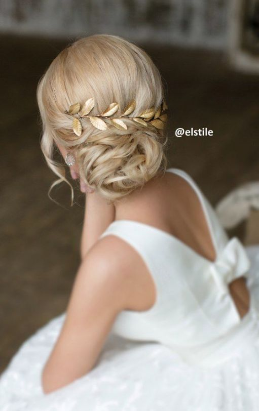 Dreamy low twisted chignon wedding hairstyle with gold vine leaf hairpiece; Featured Hairstyle: Elstile