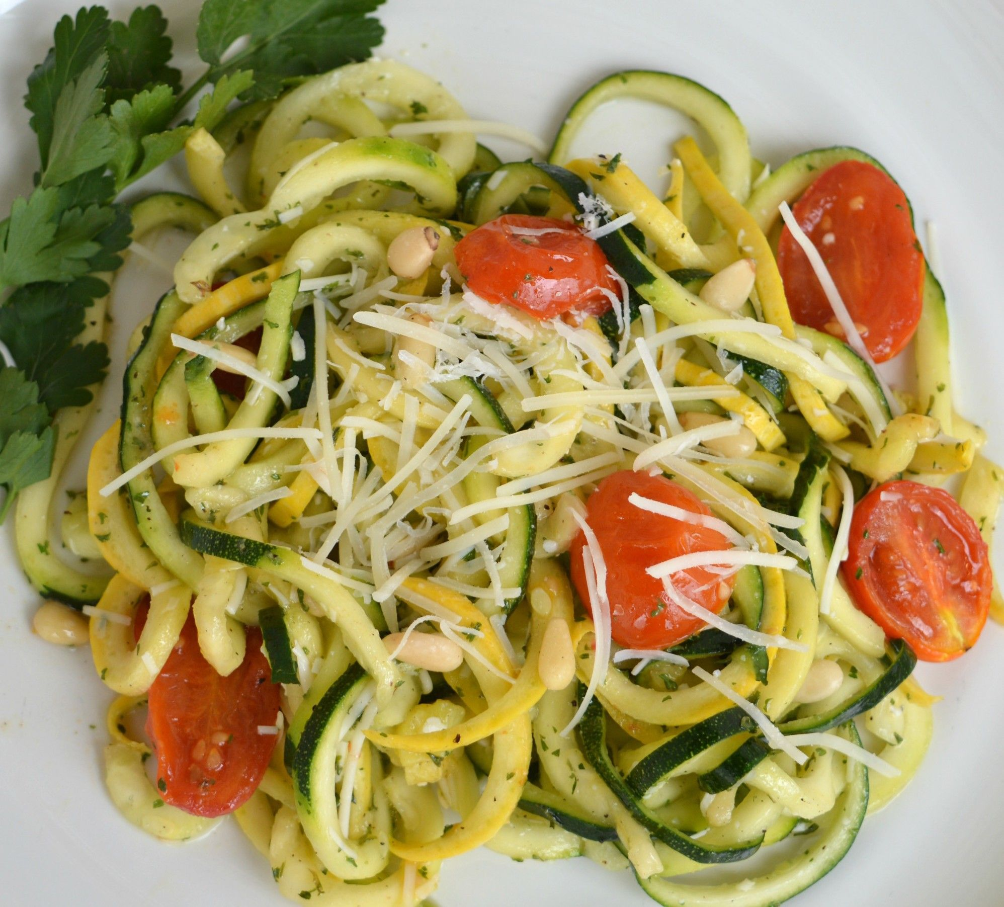 Lemon parmesan zucchini Noodles with roasted tomatoes and pine nuts. Perfect vegetarian meal for Spring!
