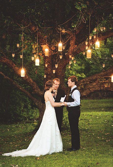 under a big tree! Love the lanterns!