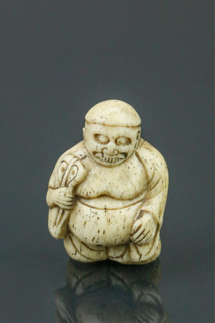 Japanese ivory netsuke; featuring Japanese folk creature Kappa; 19th century; two-character artist signature on base; pierced for suspension; H: 4 cm, W: 3 cm, 21 grams