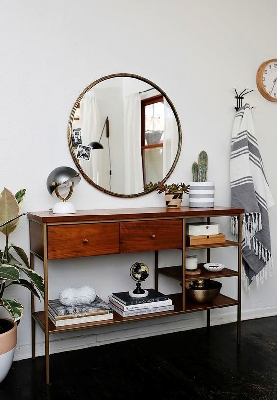 wooden mid century modern console with drawers and a lot of shelves