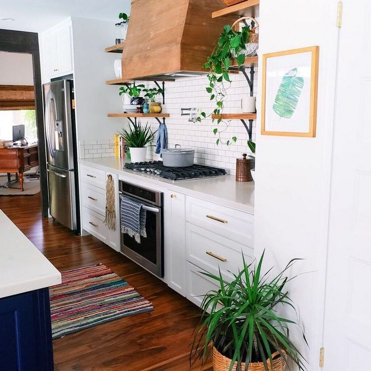 Custom white cabinetry with sharpened marble ledges, maple ...