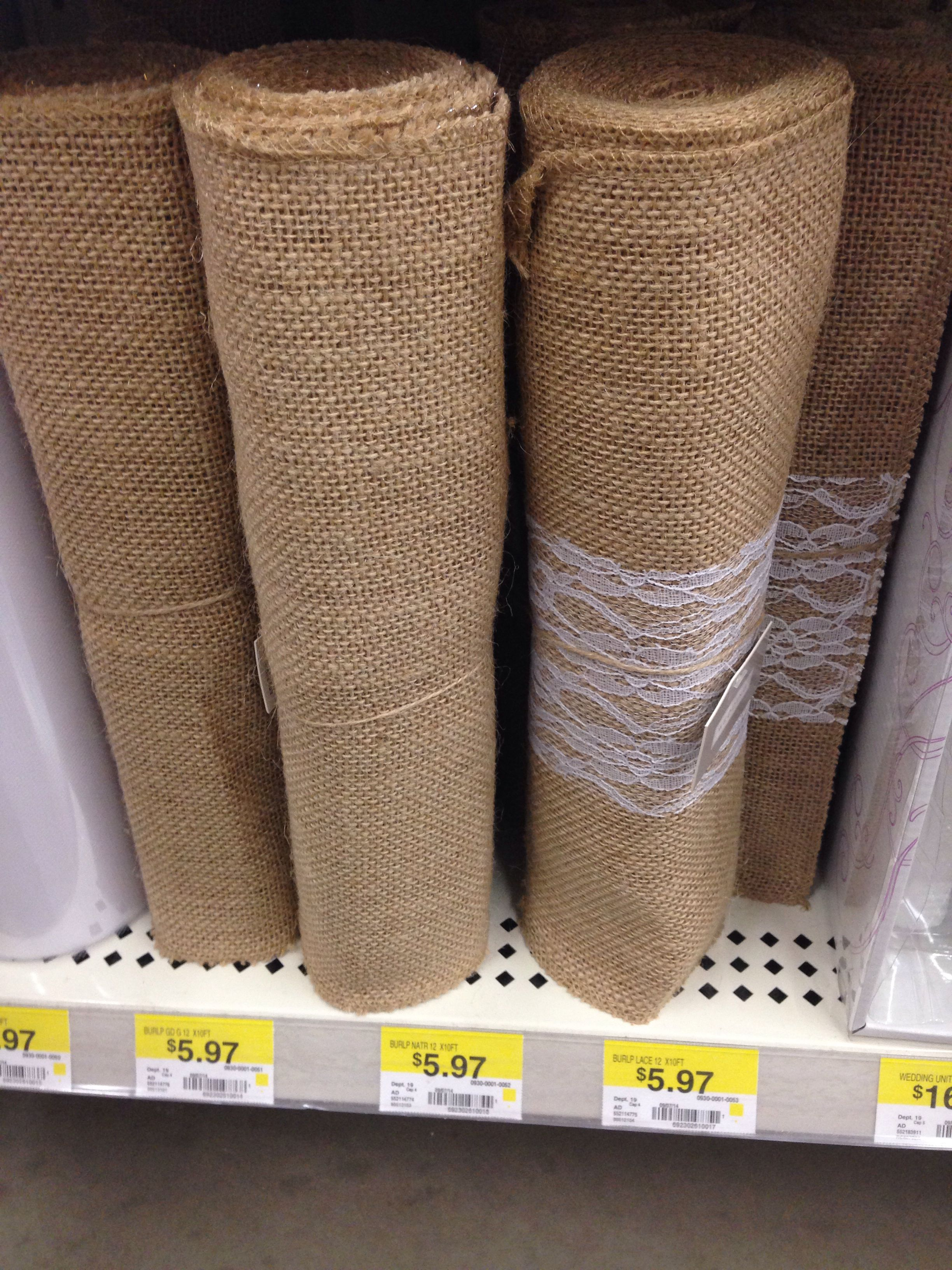 At Walmart, in the wedding accessories section. Burlap table runners (10ft)  w/ and w/o lace for ~$6.00