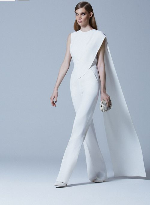 3cd8d083a140 SWOONING over this jumpsuit! There is a bride out there that would LOVE  this look for the big day. The avant-garde bride for sure!
