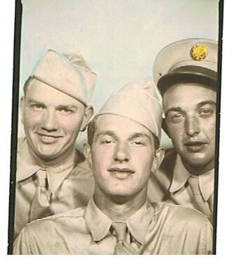 I believe this was taken at Ft Benning Georgia before they left. My Grandaddy center.