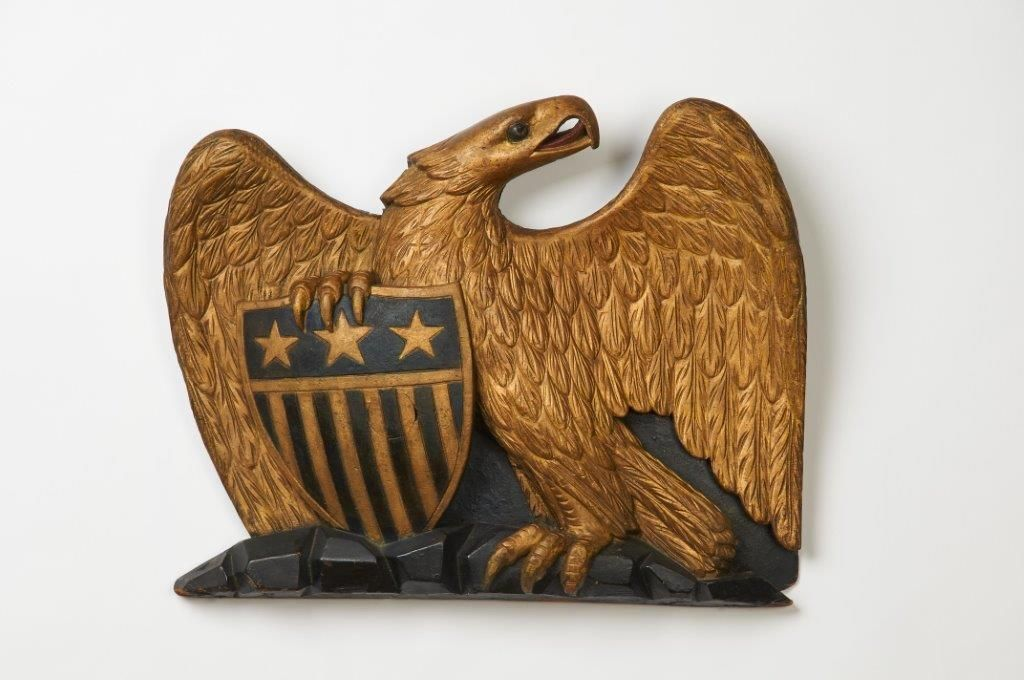 """Carved Eagle and Shield  Dimensions: Ht. 14 ½"""", W. 17 ½""""  Date / Circa: c. 1840-60  Maker / Origin: N.E. United States  Medium: Carved, painted and gilded pine"""