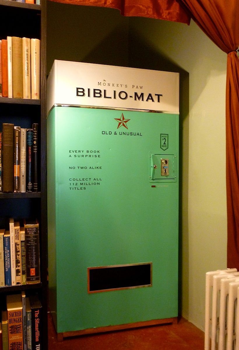 "Antiquarian BIBLIO-MAT book vending machine installed Oct 2012 at the MONKEY'S PAW Secondhand Bookshop. Toronto, Canada.  Printed on the front of Biblio-Mat:  ""Every book a surprise. No two alike. Collect all 112 million titles. Deposit 2.00 Here""   Shop: http://monkeyspaw.com/  Blog:  http://mo-paw.blogspot.com/"