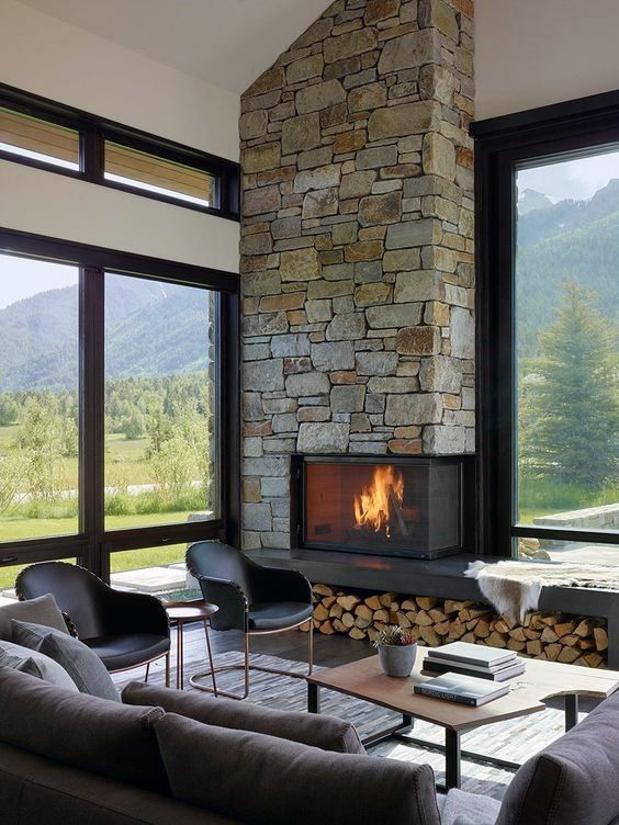 Stone Corner Fireplace Design Living Room big windows like yours are painted black for a graphic effect. Picture big blinds instead of curtains. Modern smal chairs