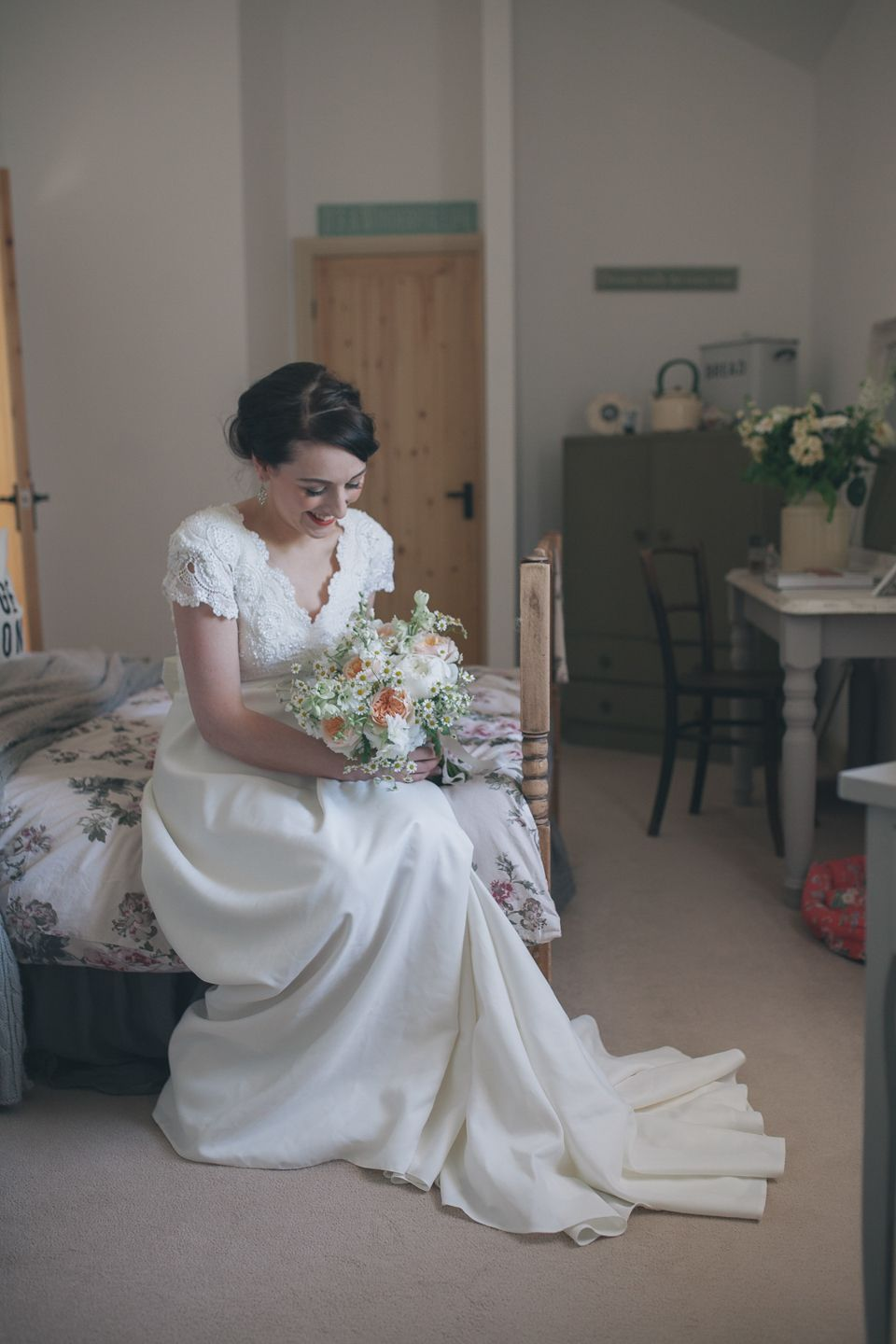 A beautiful vintage inspired village hall wedding with a bride wearing an original vintage wedding dress. Photography by Sally T