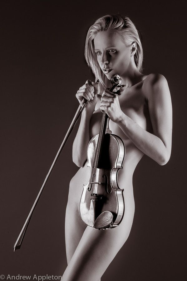 naked lady with musical instrument