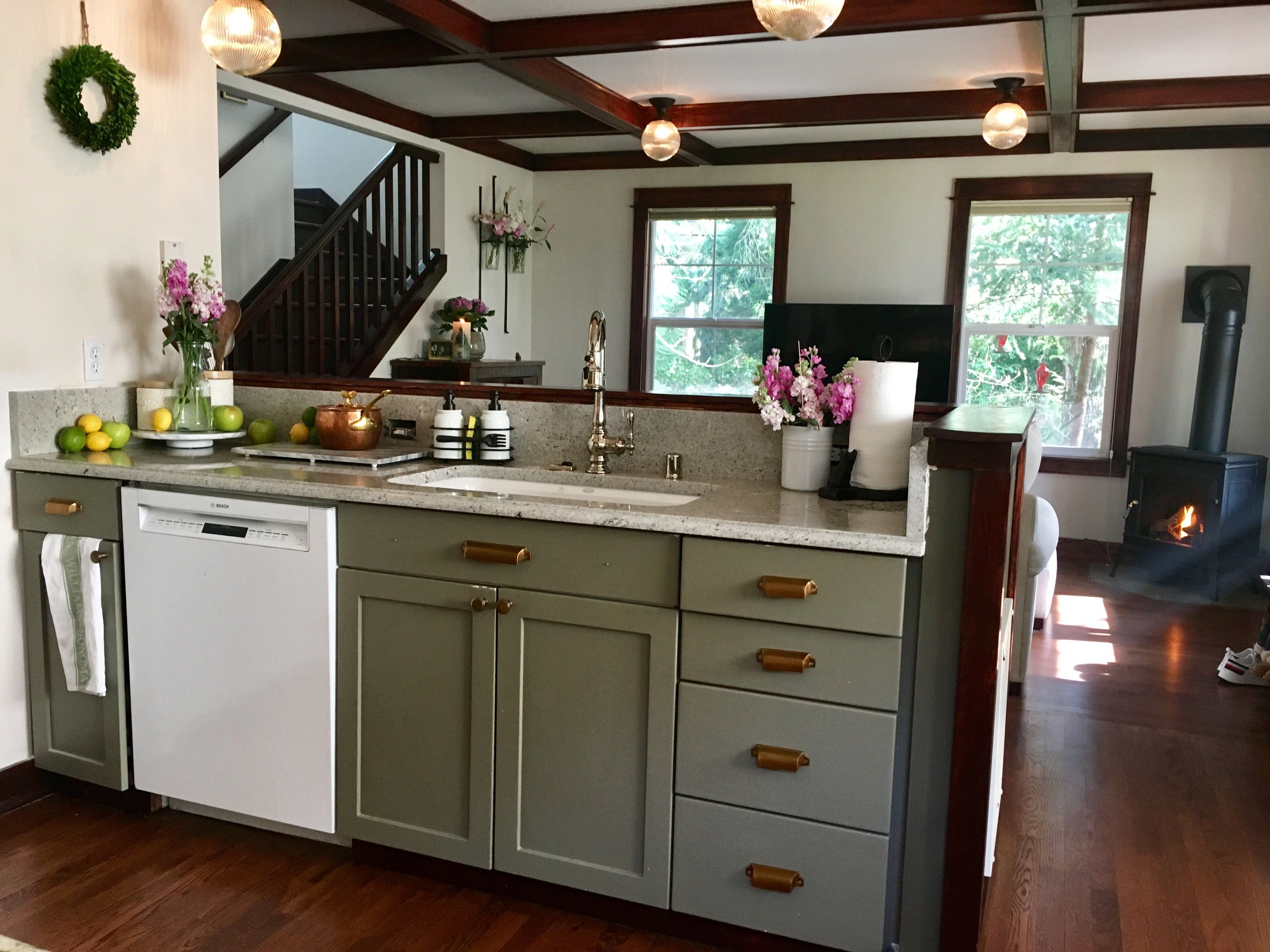 brass fixtures and a green kitchen compliment the natural green space surrounding this cottage on kitchen interior green id=25562