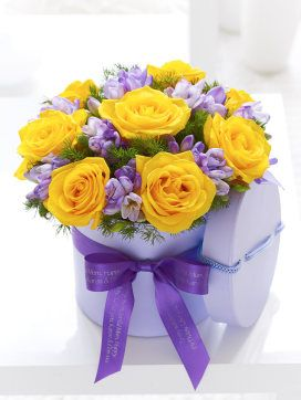 This yellow rose and freesia hat box would make a delightful this yellow rose and freesia hat box would make a delightful easter gift negle Choice Image