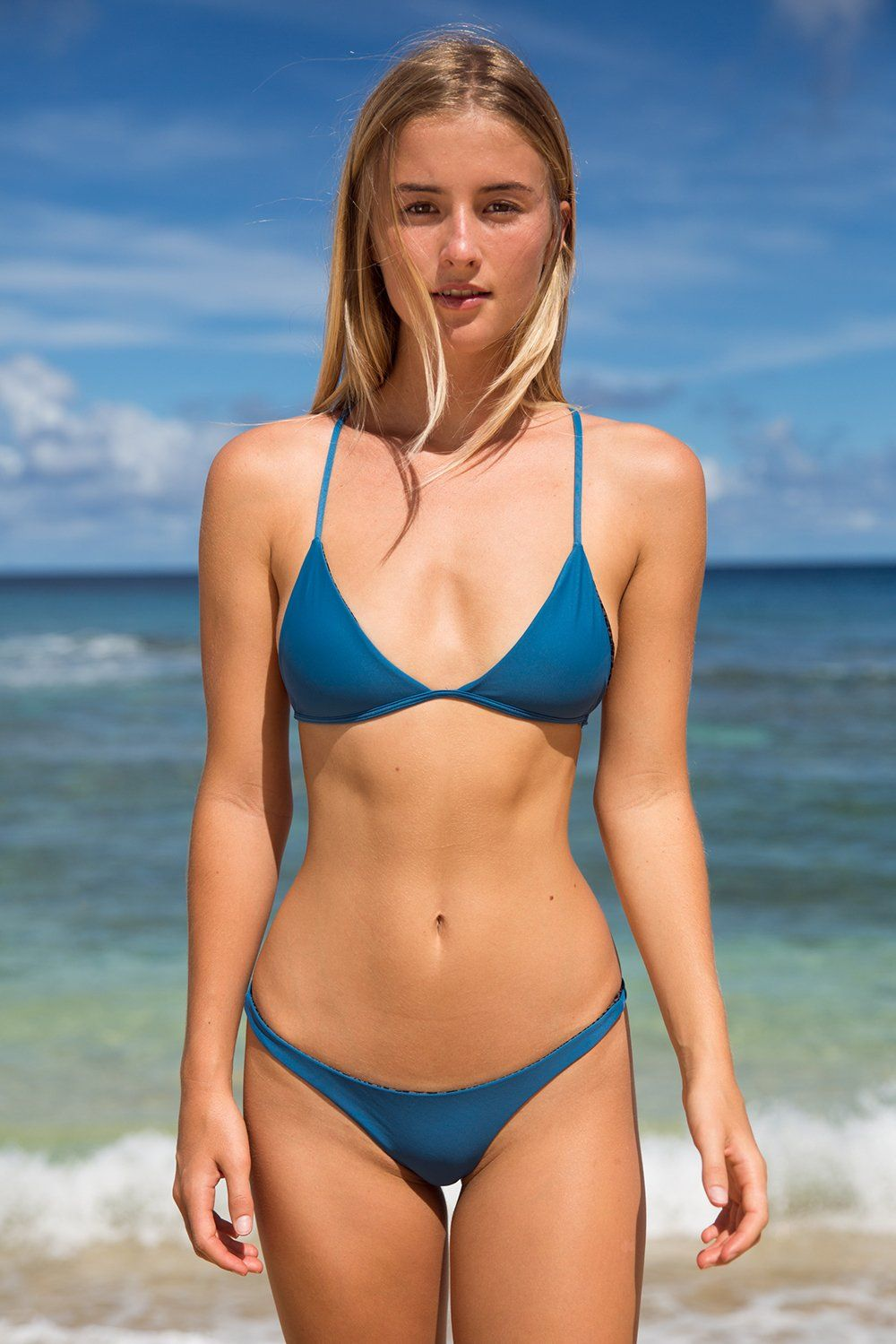 ac0735f94cb The ACACIA Shaka top features a triangle bralette with cut out detail in  the back.