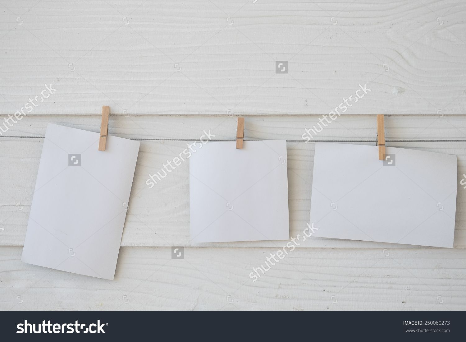 Hanging Empty Photo Paper Frame Over White Wood Background - 250060273 : Shutterstock