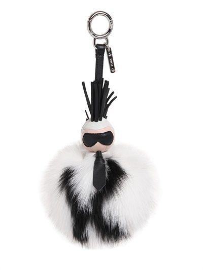 e0763838f0996 Get Kendall Jenner s Saint Laurent white leather Sac de Jour and Fendi  Karlito fur bag charms - LaiaMagazine