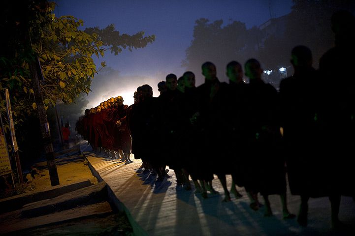 Rangoon, Burma: Buddhist monks queue up to collect alms and donations
