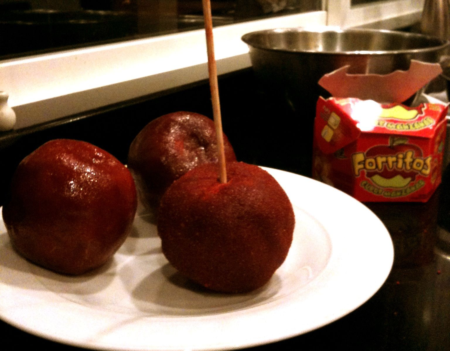 Granny smith apples covered with tamarind and chili candy